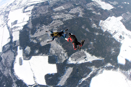 man flying: Two skydivers in the sky