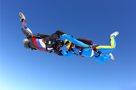 Two skydivers in the sky