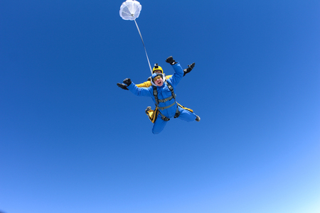 Skydiving tandem in the blue sky Stock Photo - 78253266