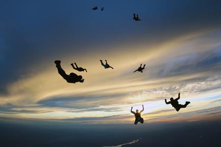 man flying: Sunset jump Stock Photo