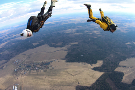 Two skydivers are moving from each other. Stock Photo