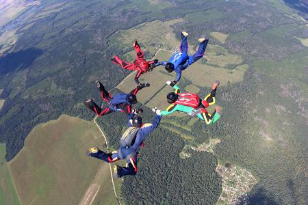 Formation of five skydivers Фото со стока