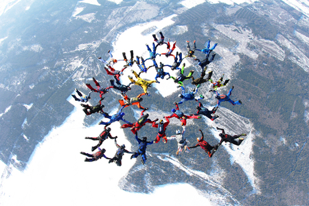 man flying: Winter skydiving formation Stock Photo