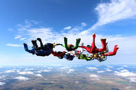 A group of skydivers in the sky.