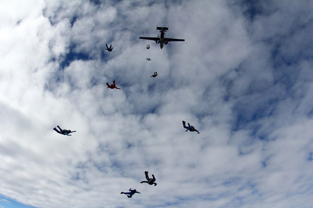 Skydivers and airplanes are in the sky. Stock Photo