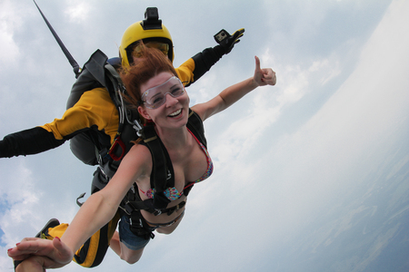 Skydiving. Girl is making signal OK. Banco de Imagens