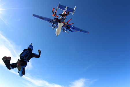 Skydivers are jumping out of a plane. Stock Photo