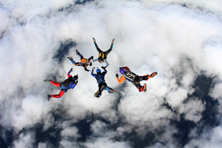 Skydivers are in the sky.