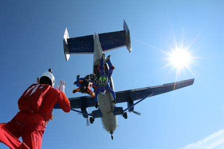 Formation skydiving. Skydivers are in the sky. 스톡 콘텐츠