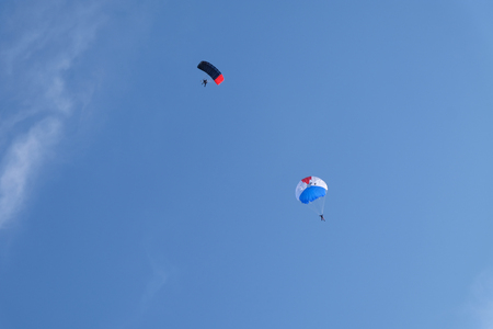 Two parachutes are in the sky.