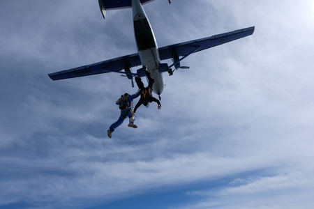Two skydivers have just jumped out of a plane.
