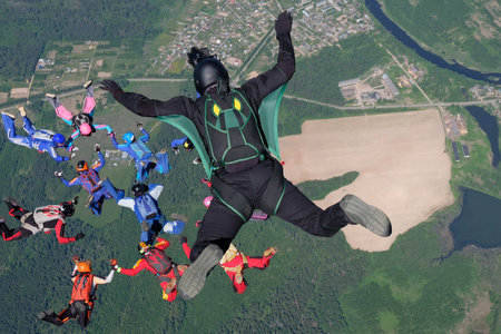 Skydiving. Cameraman makes film about skydivers. Stock Photo