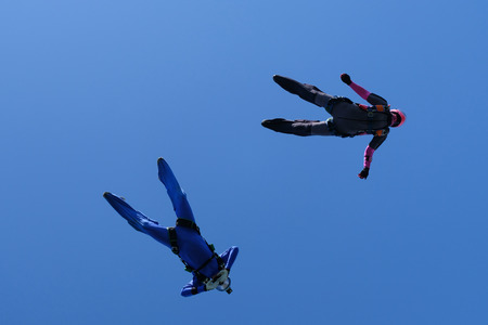 Skydiving. Two skydivers are in the sky. Stock Photo