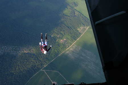 Skydiver has just jumped out of a plane.