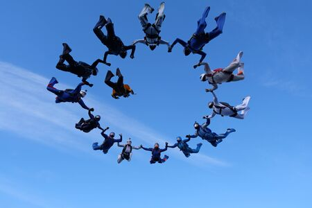 Skydiving. Skydivers have done a circle figure in the sky. 版權商用圖片