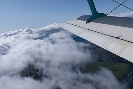 A wing of aiplane. The view from an opened door.