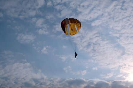 A paratrooper is in the sky
