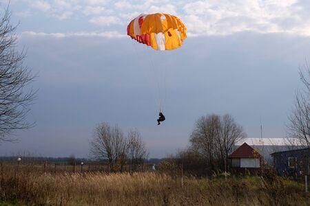 A paratrooper is landing