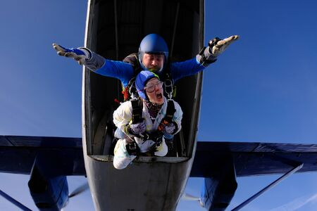 Skydiving. Tandem jump. First step.