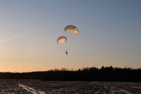 Paratrooper lands with two parachutes. Stock fotó