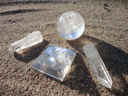 Quartz Orb, Pyramid, and Points on Sand Imagens