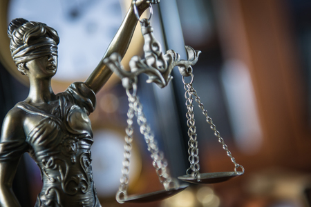 Lawyer office. Statue of Justice with gauls, gavel Stock Photo