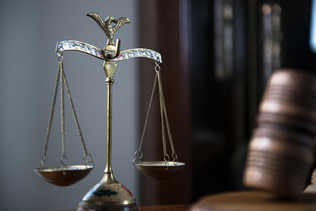 Gavel and legal book on wooden table, court room concept