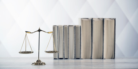 Symbols of the law on a rustic desk Foto de archivo