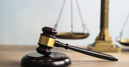 Law and Justice theme, mallet of the judge, wooden desk, books