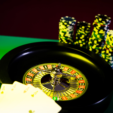 Casino concept with dice, roulette and chips. Stock Photo