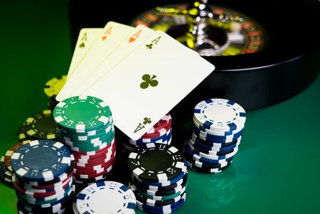 desk: Casino concept with dice, roulette and chips. Stock Photo