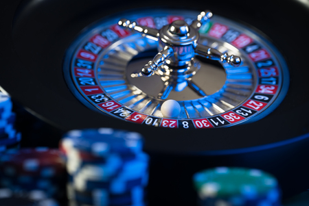 High contrast image of casino roulette and chips