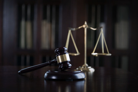 Symbols of Law and Justice on Lawyers desk in Law Office