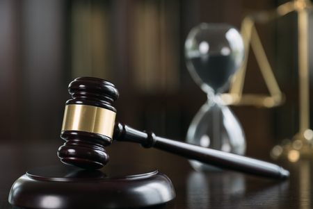Law Concept. Judges gavel, hourglass Stock Photo