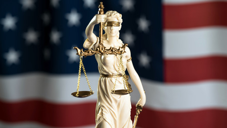 Burden of proof - Moodily lit legal concept with Scales of justice Stock Photo