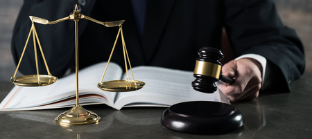 justice and law concept.Male lawyer in the office with brass scale Stock Photo