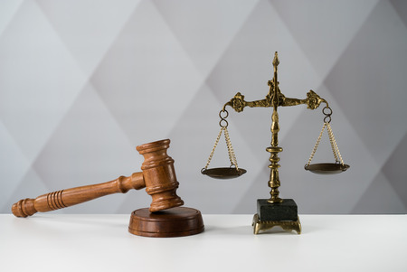 Law theme. Wooden gavel and scale Stock Photo