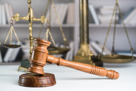 Judge gavel and legal book on wooden table close up Stock Photo