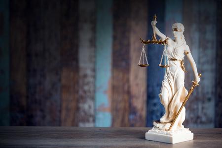 Justice symbol on rustic background. 版權商用圖片