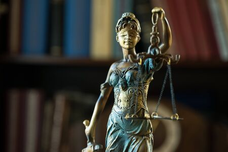 Law and Justice concept. Mallet of the judge, books, scales of justice. Courtroom theme.