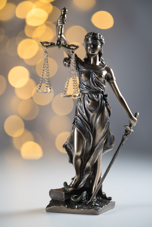 Law theme, lady justice, golden bokeh background