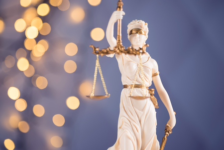 Lady justice on colorful bokeh background Stock Photo