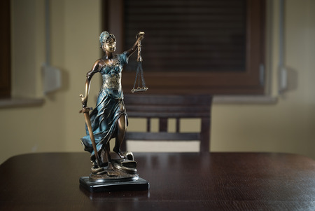 Statuette of the goddess of justice Themis with scales. Law concept