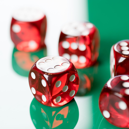 playing poker dice on green background