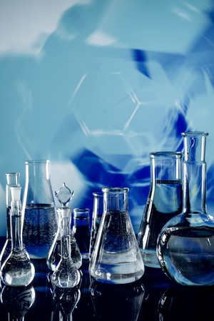 Laboratory glassware with solutions of different colors on table Banco de Imagens