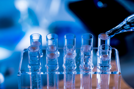 Microscope with lab glassware, science laboratory research concept Stock Photo