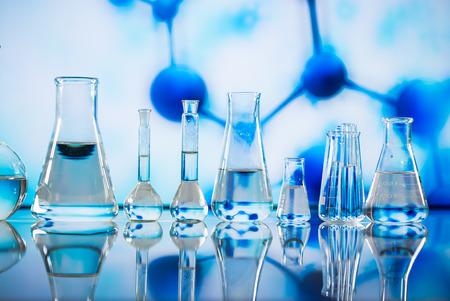 Microscope with lab glassware, science laboratory research concept Фото со стока
