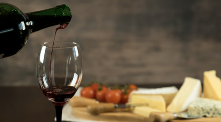 Red Wine and cheese board Stock Photo