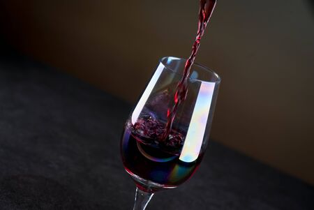 Bartender pours red wine 스톡 콘텐츠