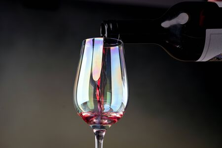Red wine being poured into a glass close-up